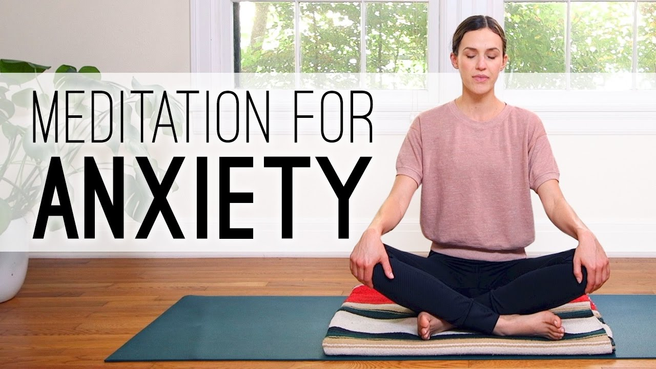 This lady is doing some yoga relaxation poses that helps to calms anxiety