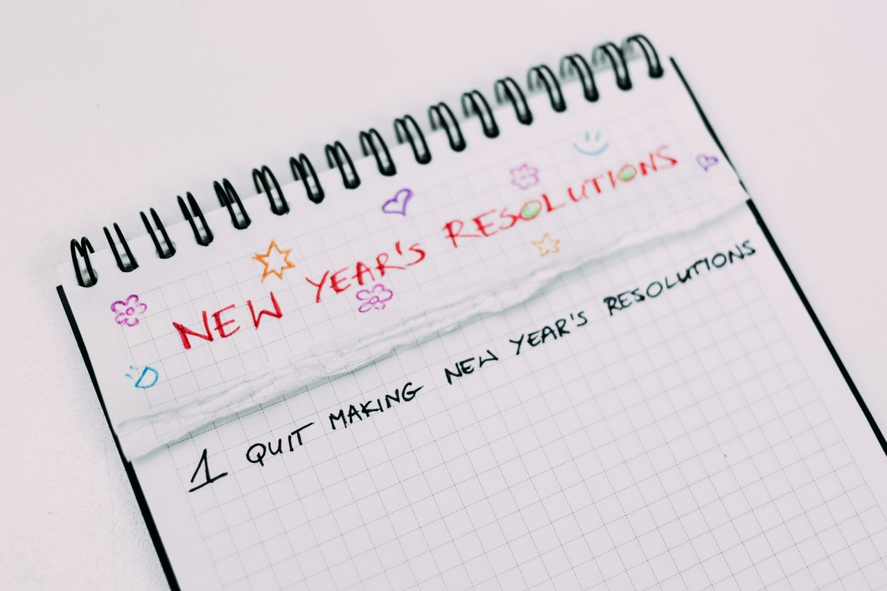 A notebook with some colourful graffiti to write the new year resolution for some changes