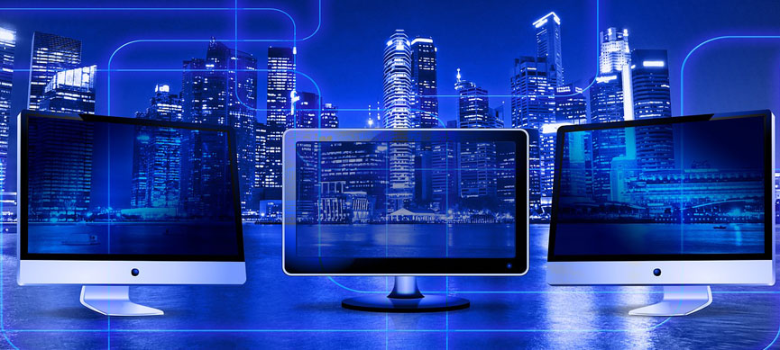 3 monitors in Nigeria serving to do online businesses with a dark blue city behind