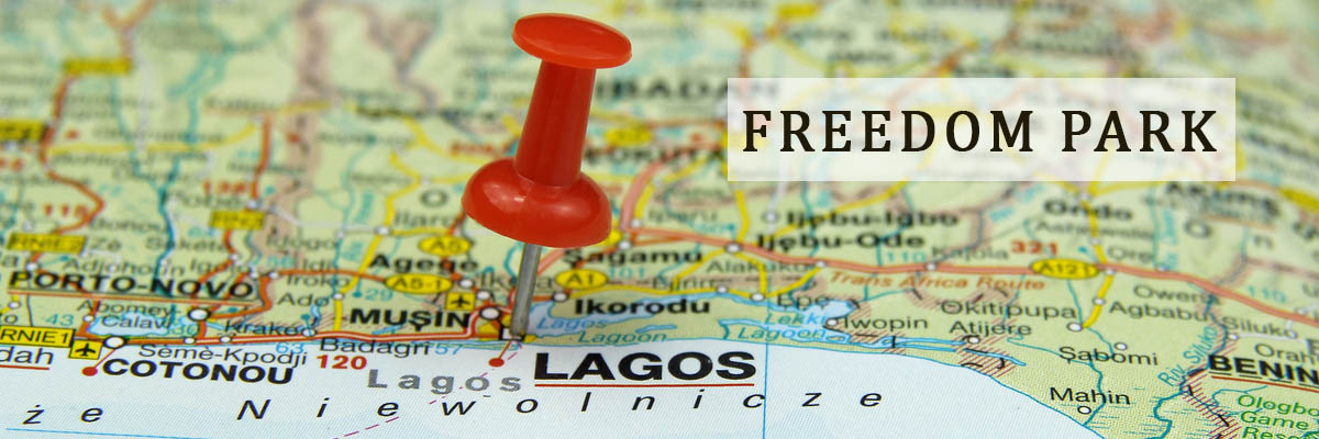 a world map with a red pin on the place of Lagos indicating the freedom of Lagos