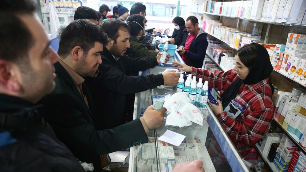 Iranians buying proteective masks in a drugstore to prevent contracting coronavirus