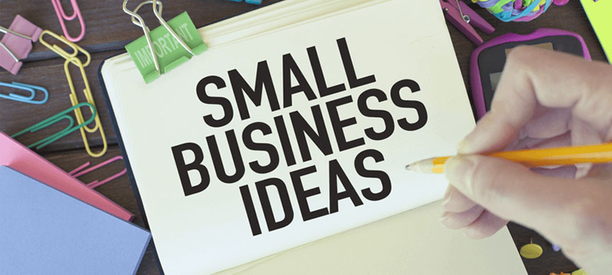 small business idea lettering written on white paper with a yellow pencil on the side