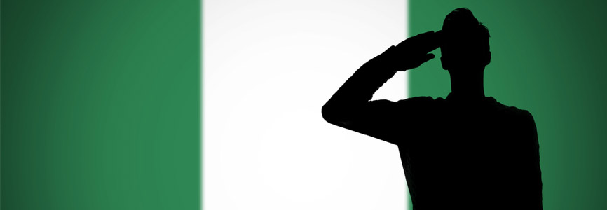 Nigerian navy silhouette saluting the flag of Nigeria