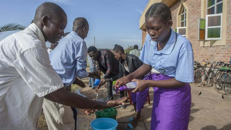 Parishioners wash hands as a preventive measure against the spread of the coronavirus in Lilongwe, Malawi