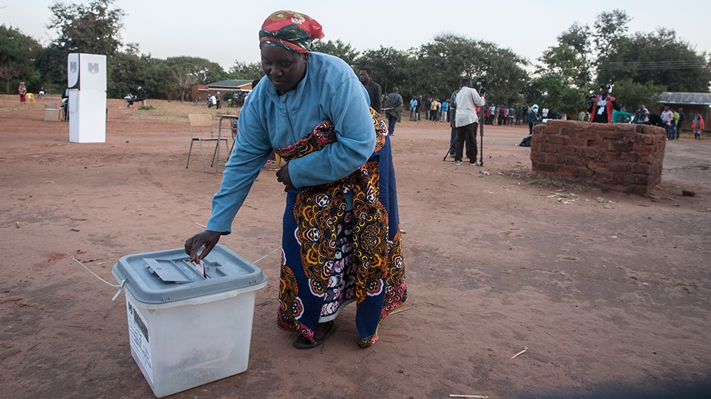 A woman casts her ballot during the current election in Malawi at the Malembo polling station in Lilongwe