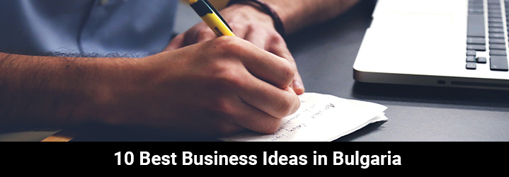 This person is writing some business ideas to develop in Bulgaria on paper using a pen