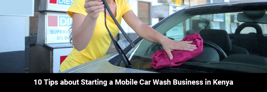 A woman in a yellow T-shirt is cleaning a car with a pink microfiber towel working as a mobile car washer in Kenya