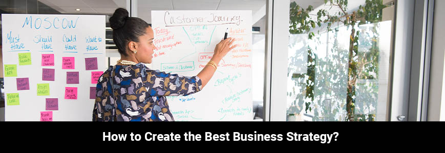 A businesswoman doing a meeting explaining on whiteboard about business strategy inside glass-panel office