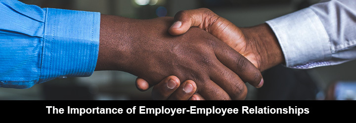 The employer and the employee in long-sleeve shirt shake hand to maintain a good relationship