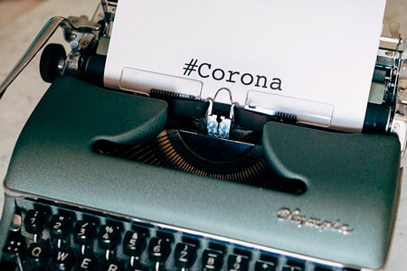 "typewriter with a sheet where it is written ""#corona"""