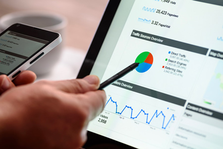 Google Analytics on the laptop for effective SEO. SEO is a useful marketing idea for your business