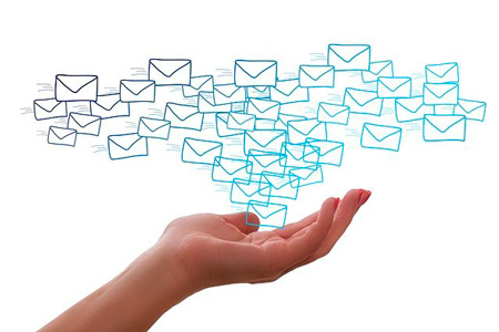 A hand with some of the virtual mails to show the importance of directing mails as one of the best marketing ideas