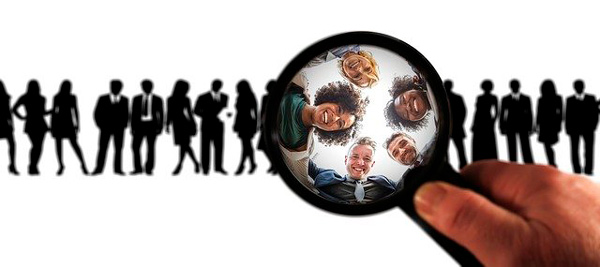 a lot of people where a man is with magnifier choosing the best customers for customer relationship marketing