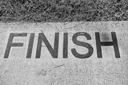 """The inscription on the asphalt """"finish"""", you should finish things you start to build your discipline"""