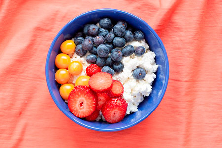 A plate with cottage cheese and fruits  for your healthy diet, which is important thing to build discipline