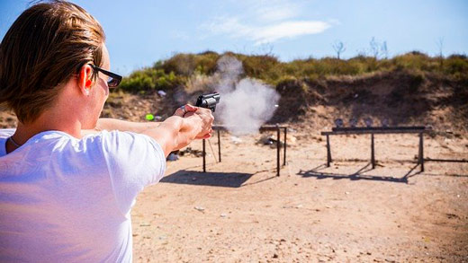 A man is shooting a gun on a shooting range which is one of the way to make money with land