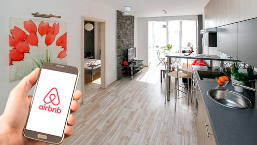 Airbnb app on the smartphone in a rented flat for airbnb business