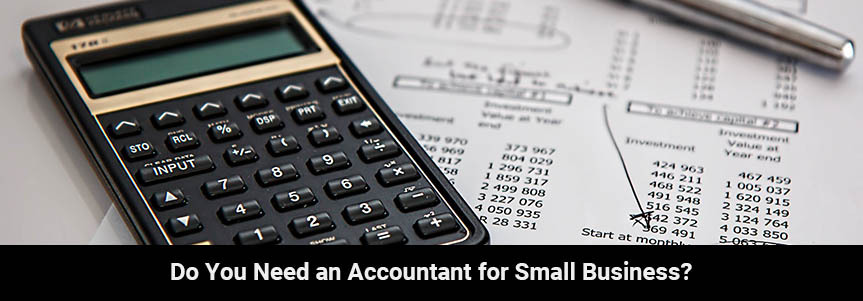 a bundle of paper with a calculator and pen an accountant working on the budget for a small business