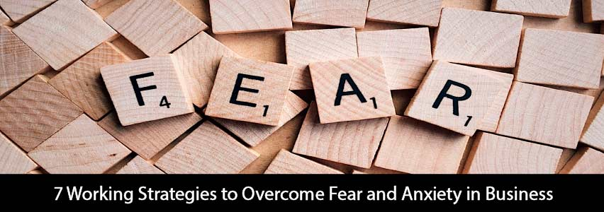 "some wooden squares with written letters ""Fear"" to describe some strategies to overcome fear in business"