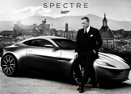 Black and white photo of James Bond  nearby Aston Martin.