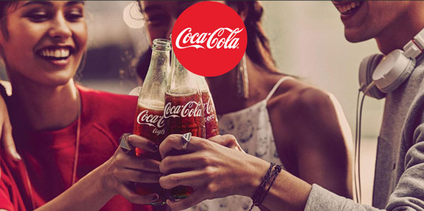 two women with a man are drinking coca-cola. Coca-cola as an example of a big green business.