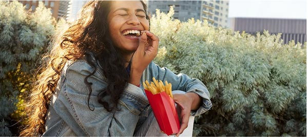a girl is eating some mcdonalds fries