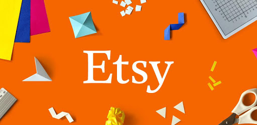 Etsy logo on the orange table with some colorful papers