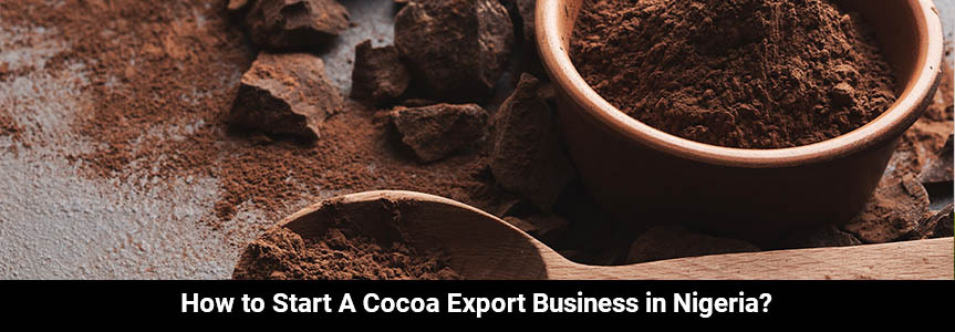 cocoa powder in a wooden bowl with wooden spoon on a table doing an exportation business in Nigeria
